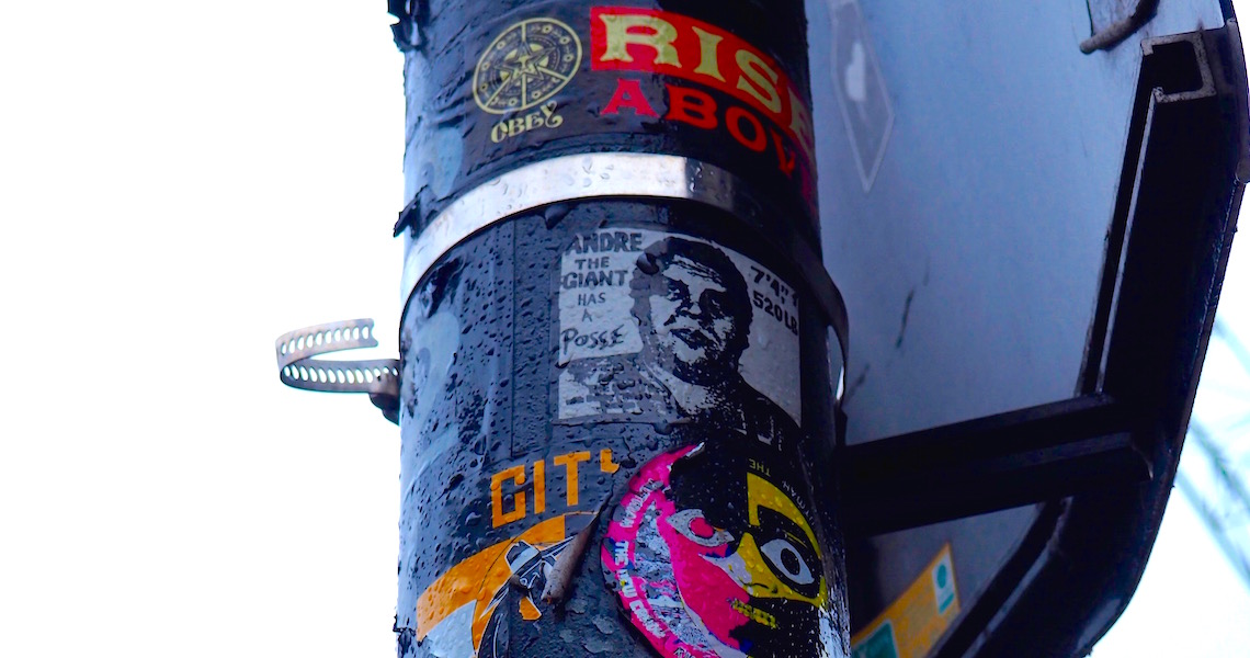 Shepard Fairey sticker on the lamppost